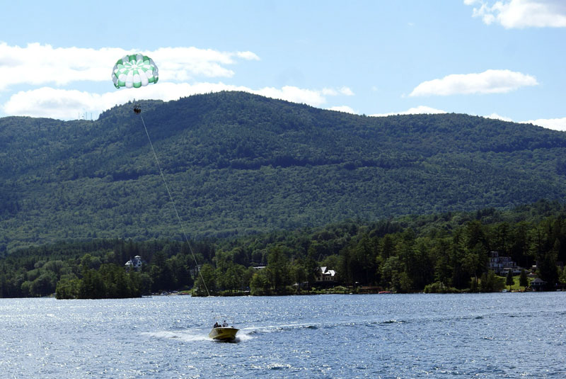 boat towing parasailers on lake george
