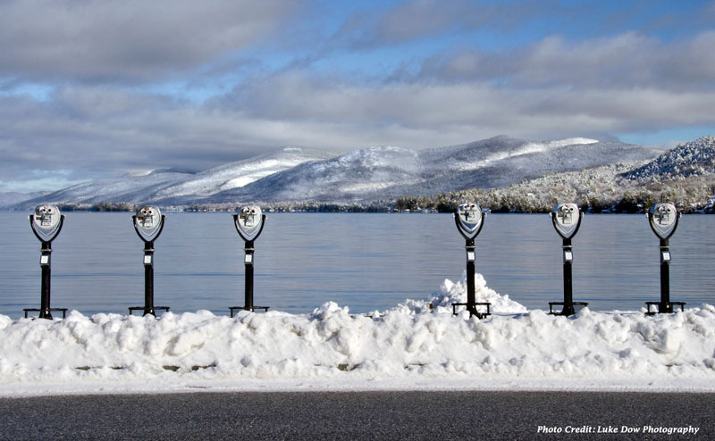 viewing devices on the shore of lake george in the snow