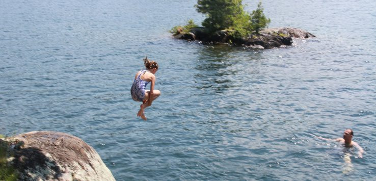 Jumping into the clear waters of Lake George NY