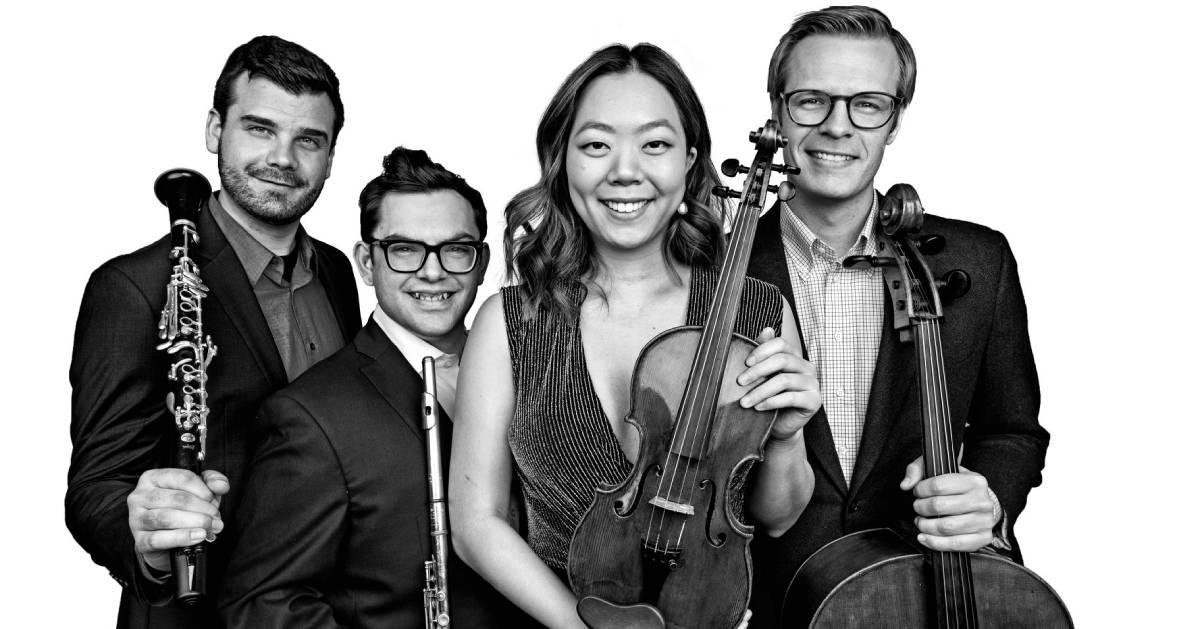 black and white photo of quartet