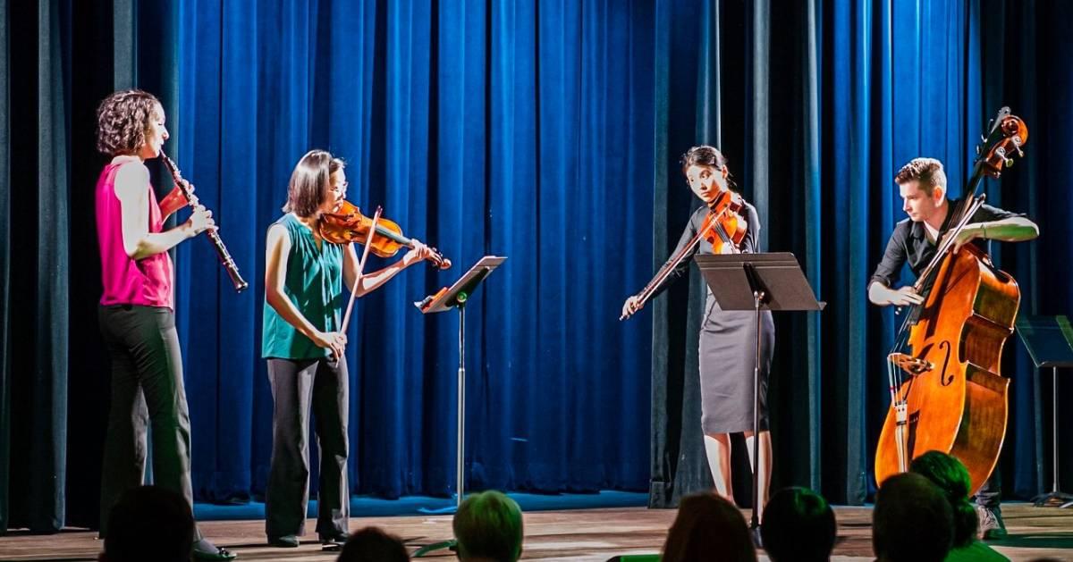quartet performs on stage