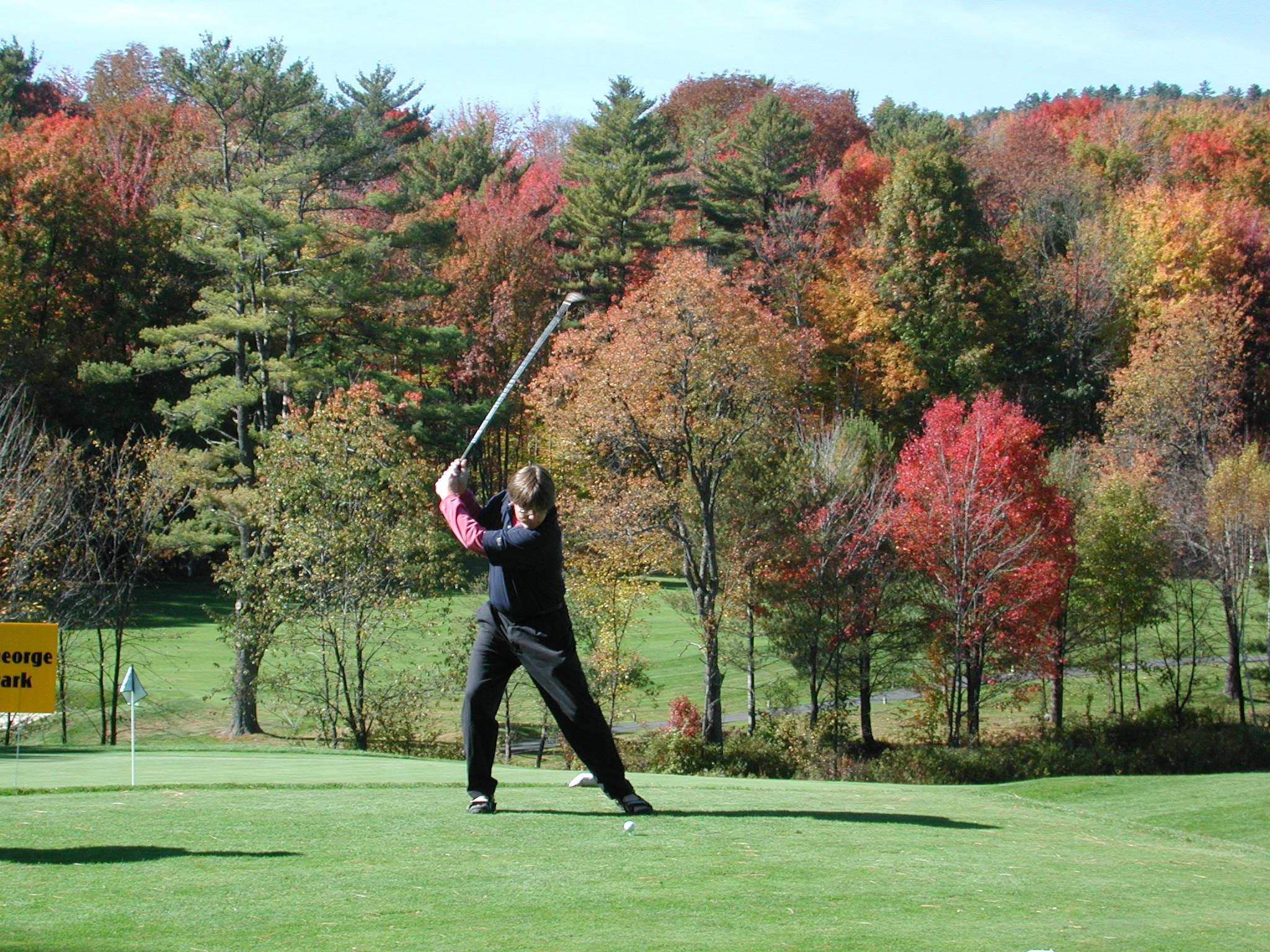 man golfing during the fall season