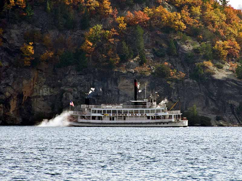 Minne Ha Ha steamboat cruising on Lake George in autumn