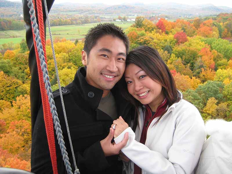 Newly engaged couple on a hot air balloon ride in fall