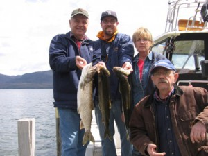 Rick JonathanTerri and Dan bring some nice lakers to the smoker!.jpg