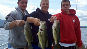 Boys with Bass on Lake George Highliner Charter Fishing.jpg