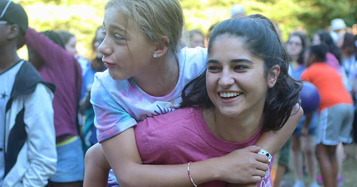 Counselor and Camper embracing