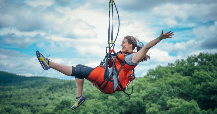 woman going down a zipline