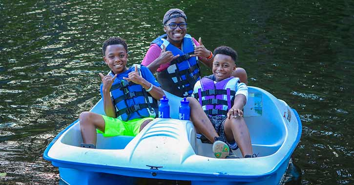 Counselor and Two Campers on boat