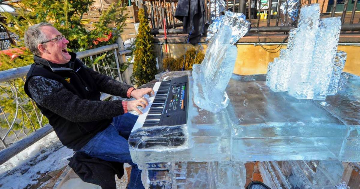 man playing ice piano
