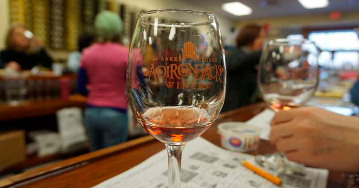 glasses of Adirondack Winery wine at a counter