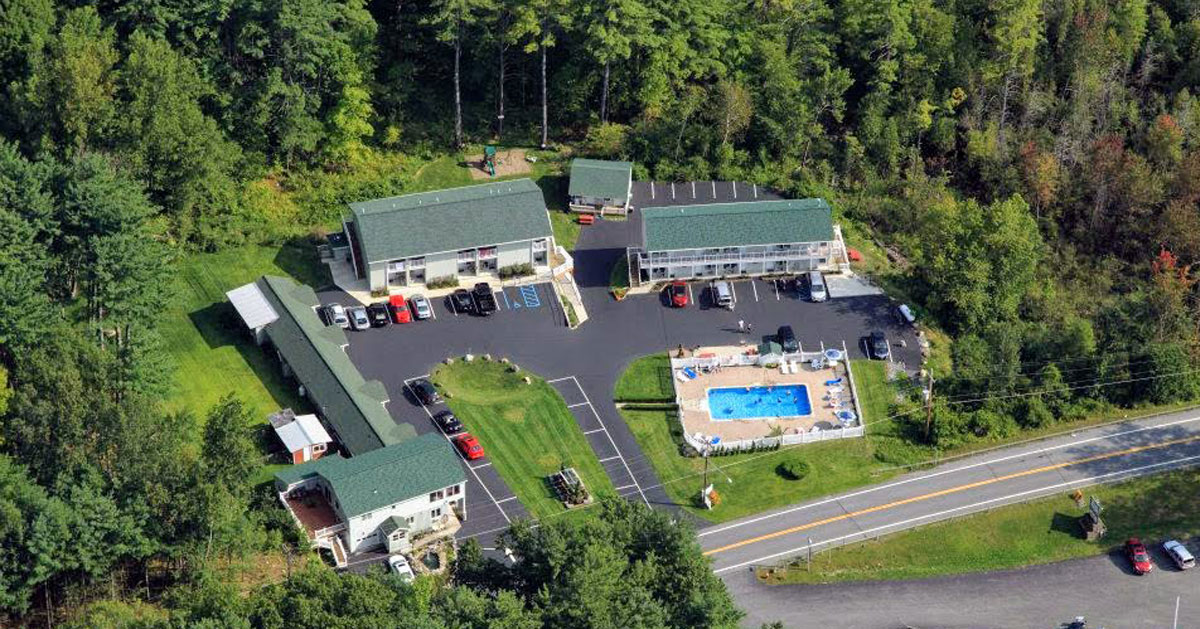 aerial view of motel with pool