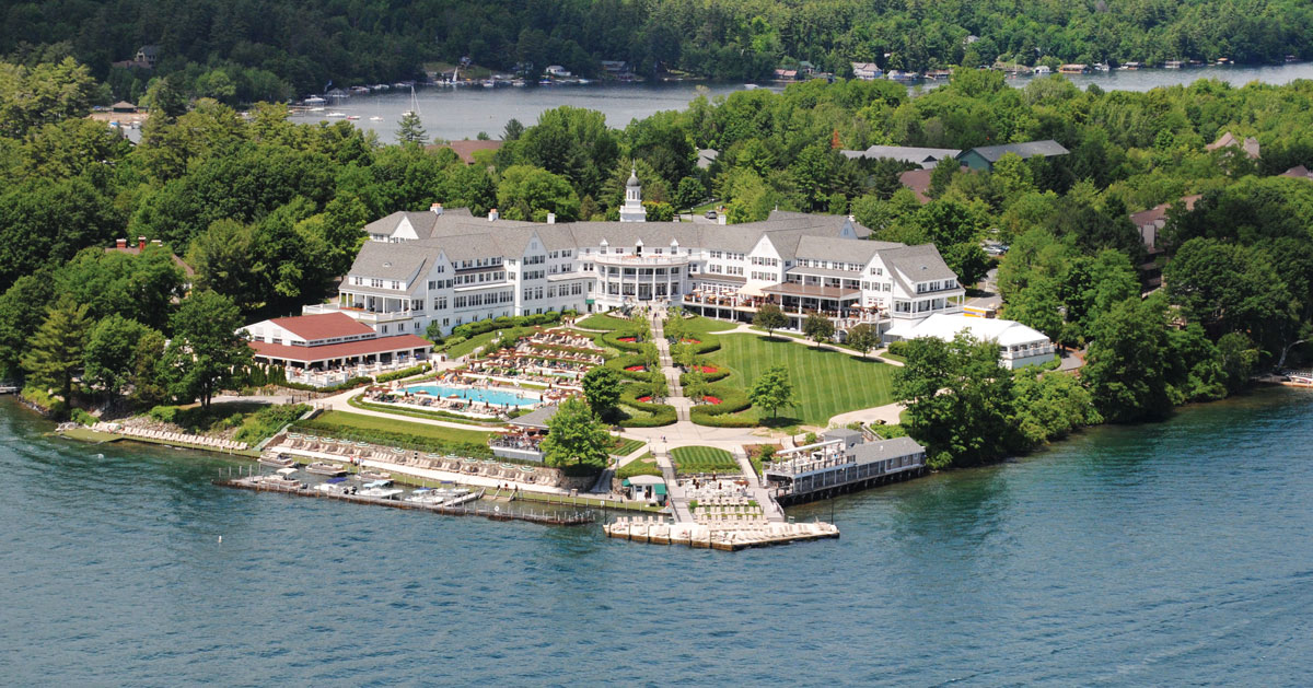 aerial view of resort by lake