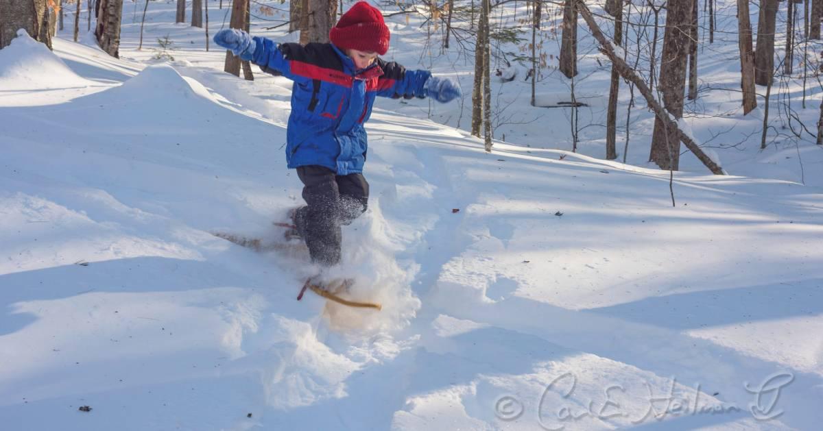 a kid snowshoes