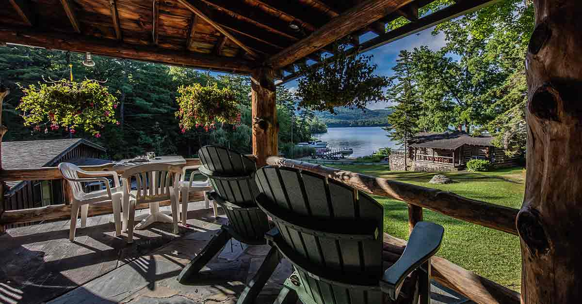 Adirondack chairs on deck with lake view