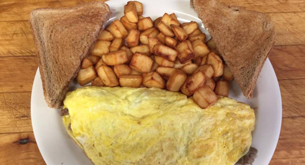 an omelet and home fries and toast on a plate