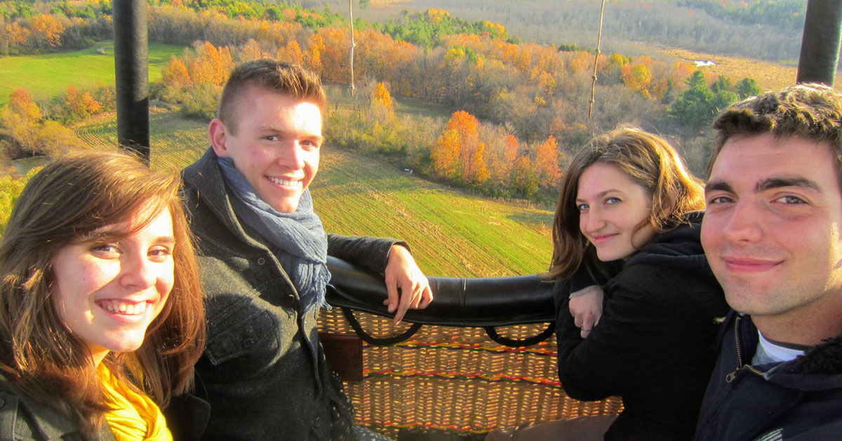 two couples on balloon ride in the fall