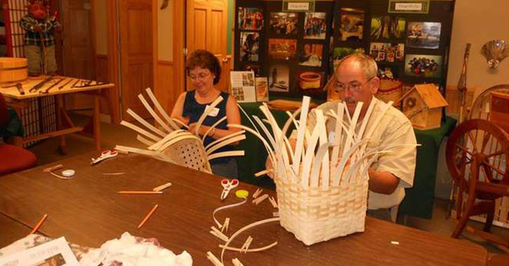 two people basket weaving