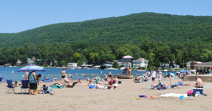 people on the beach at lake george