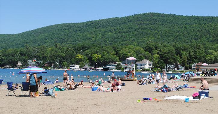 people on the beach at lake george