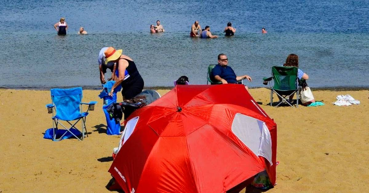 red umbrella, peole on beach