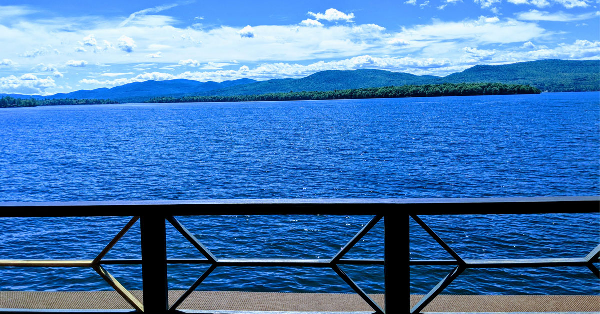 view of lake and mountains from a deck