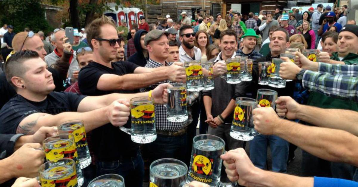 group of people cheersing with beer glasses