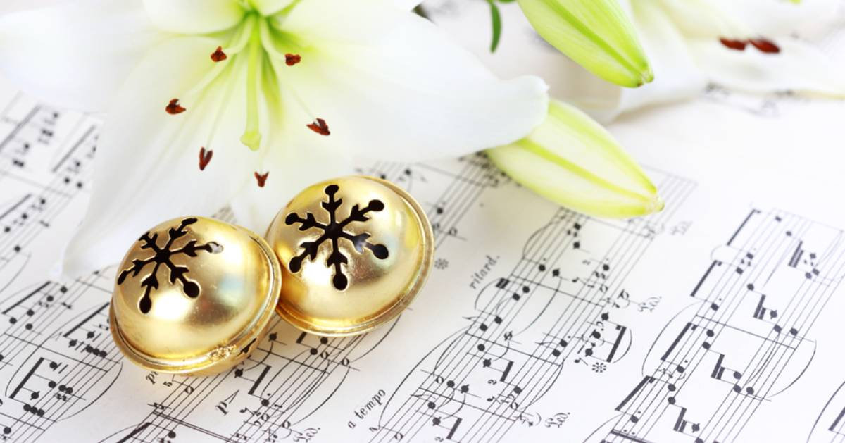 bells on music sheet with flower