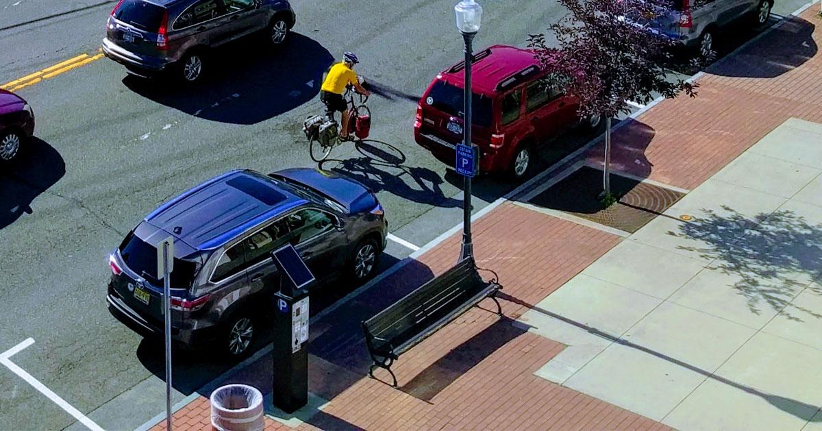 biker going by street parking