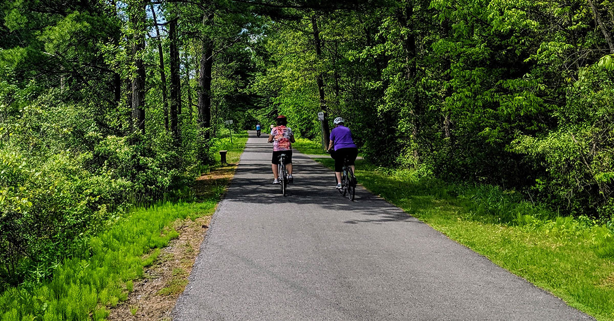 two bikers riding on the warren county bikeway