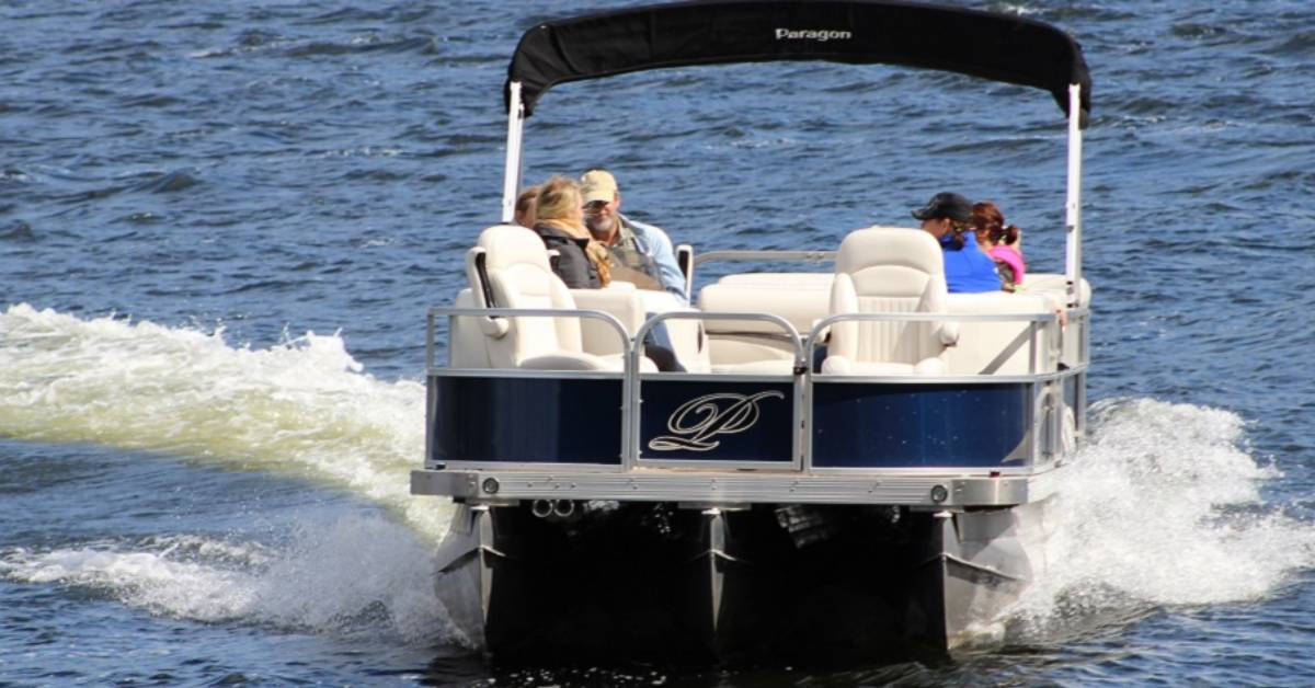 group of people riding in a pontoon boat