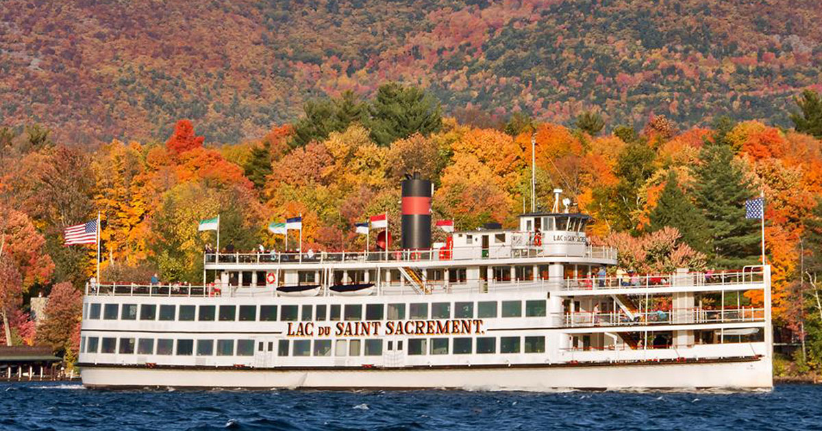 cruise ship by fall foliage