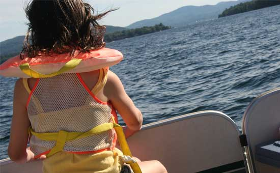 back of young girl on boat