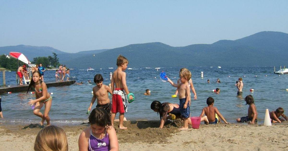 kids playing on a beach in bolton landing