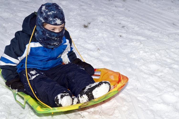 boy sledding