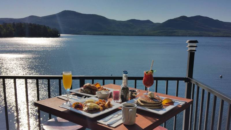 brunch on deck with view of Lake George