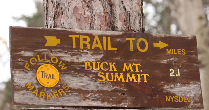 a sign for Buck Mountain