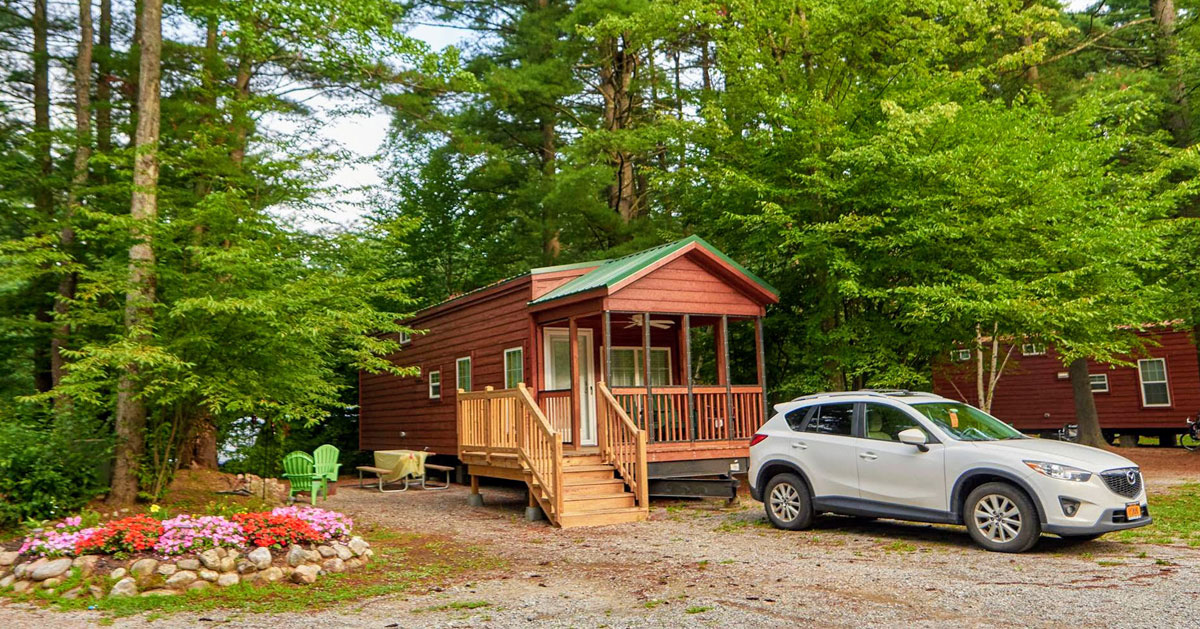 site with a cabin and car