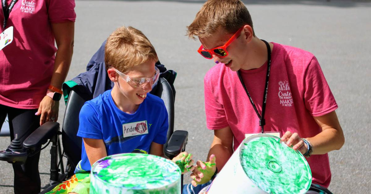Counselor and Camper painting buckets