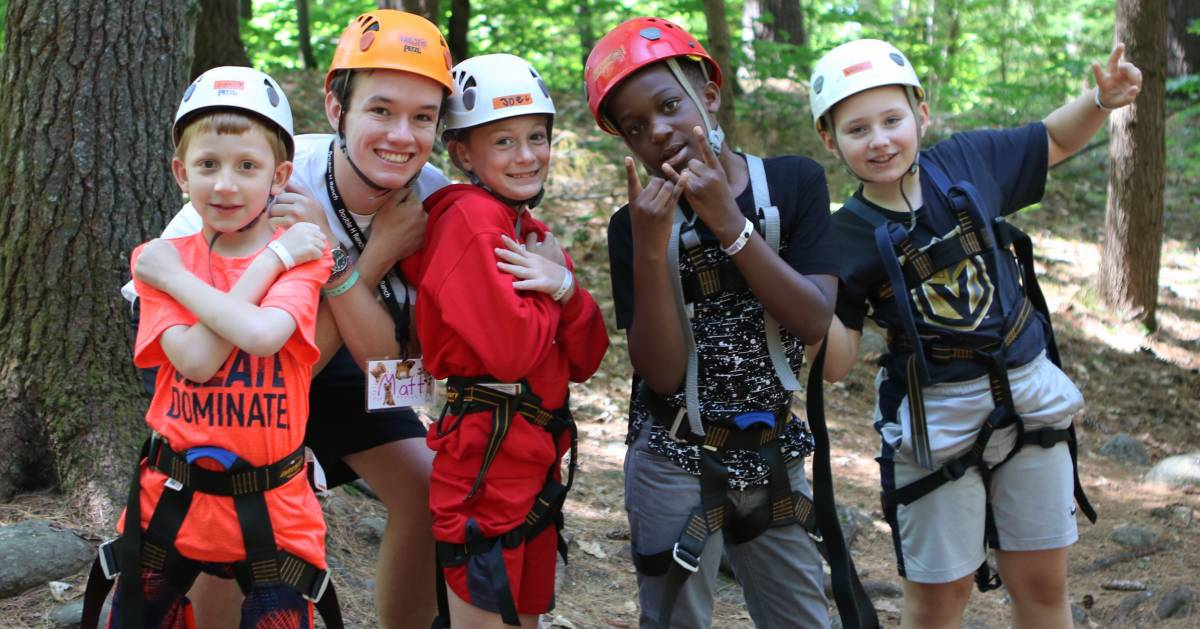 kids in helmets geared up for ropes course