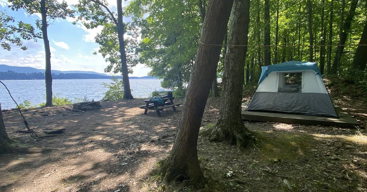 campsite near water with a tent