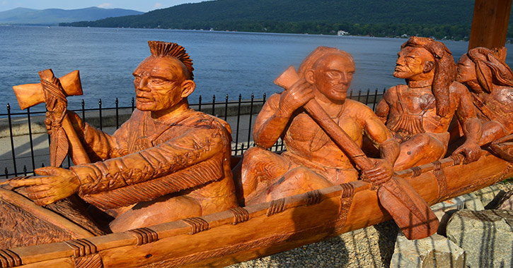 canoe carving lakefront.