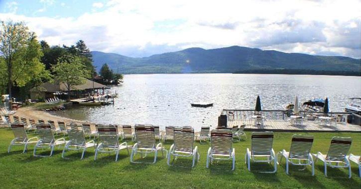 lawn chairs set up facing the lake