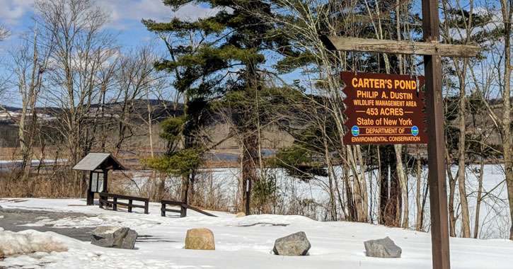 a sign for Carters Pond