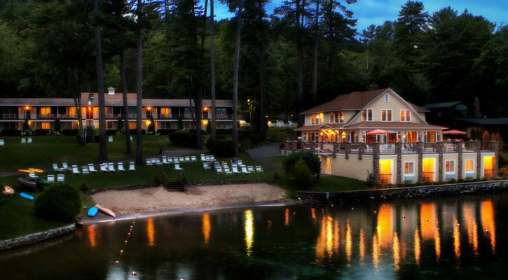 nighttime view from the water of Chelka Lodge