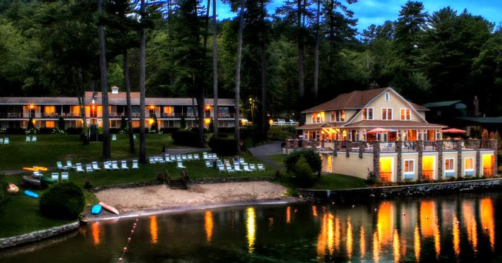 a view of Chelka Lodge at night from the water