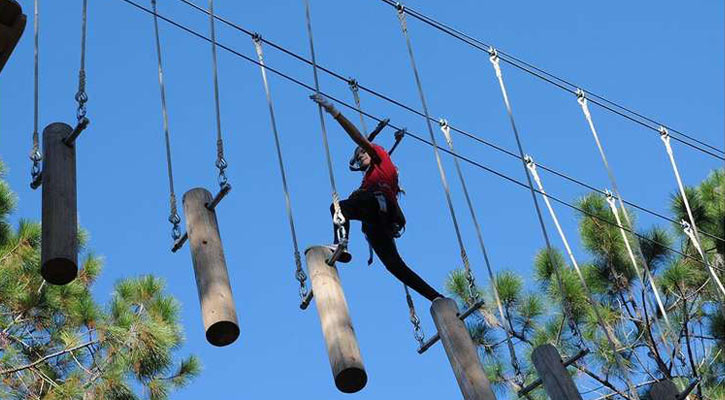 peron traversing an obstacle course in the air with logs