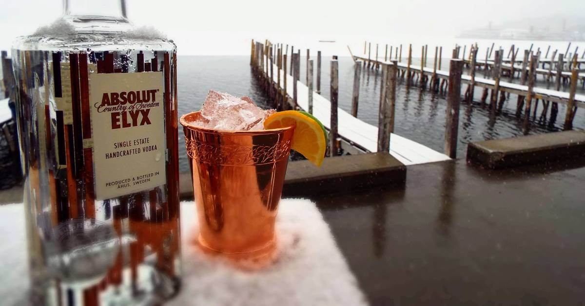 cocktail outdoors by lake in winter