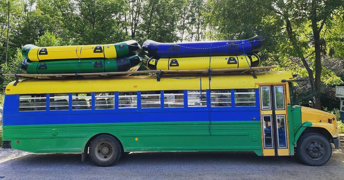 colorful bus with rafts on top