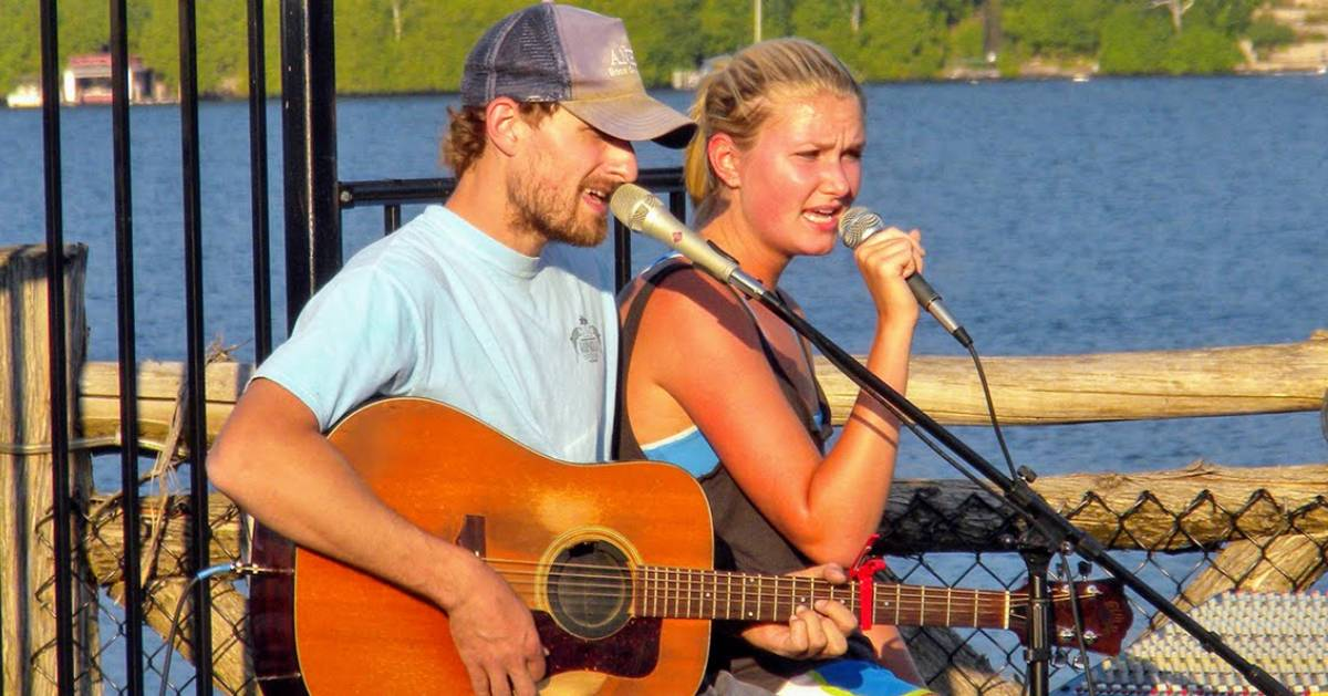 a couple singing with guitar and microphones